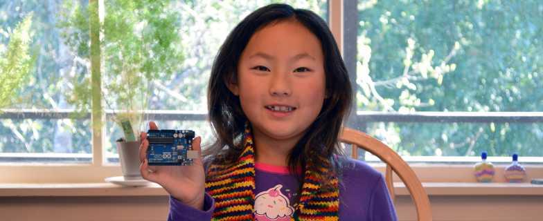 Dee holding an Arduino